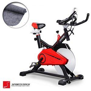 Sportstech Profi Indoor Cycle SX100 mit 14KG Schwungrad, gepolsterter Armauflage, Komfortsattel mit Sitzfederung, Pulsmessung – Speedbike mit flüsterleisem Riemenantrieb – Bodenschutzmatte gratis