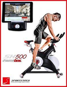 Sportstech Profi Indoor Cycle SX500 mit Smartphone App Steuerung + Google Street View, 25KG Schwungrad, Armauflage, Pulsgurt kompatibel – Speedbike in Studioqualität mit SPD Klicksystem – bis 150 KG