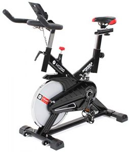 Miweba Sports Indoor Cycling MS200 Fitnessbike – 13 Kg Schwungmasse – Stufenfreie Widerstandsverstellung – Stoßdämpfer – Tablethalter (Schwarz)